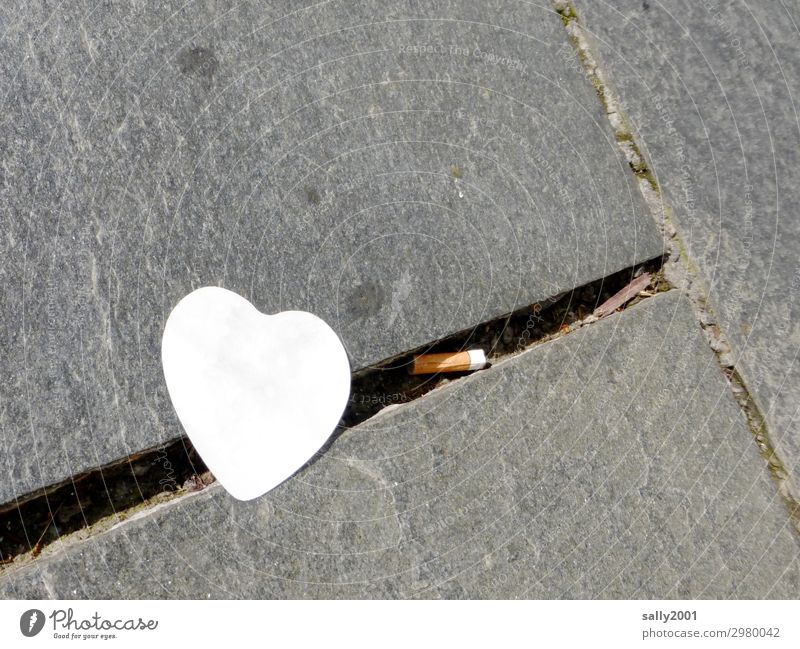 lost love... Heart symbol Love Piece of paper post-it Notepad cigarette butt Cigarette Butt Paving stone Cobbled pathway Lanes & trails Stone Street Gray