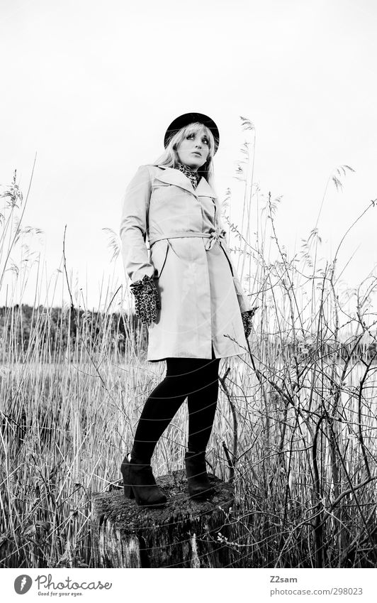 Chic in reeds Elegant Feminine Young woman Youth (Young adults) 18 - 30 years Adults Nature Landscape Bushes Common Reed Lakeside Fashion Coat Blonde