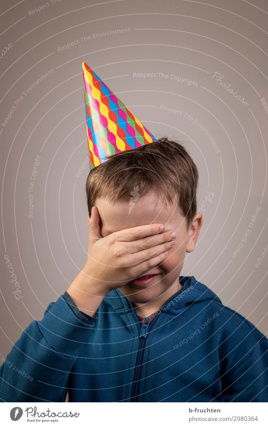 It wasn't me. Joy Leisure and hobbies Playing Feasts & Celebrations Carnival Child Face Hand 1 Human being 3 - 8 years Infancy Hat Movement Happiness