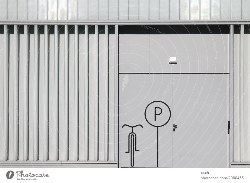 Town Wall (building) Wall (barrier) Facade Gray Line Transport Bicycle Signs and labeling Cycling Signage Capital city Downtown Parking lot Industrial plant