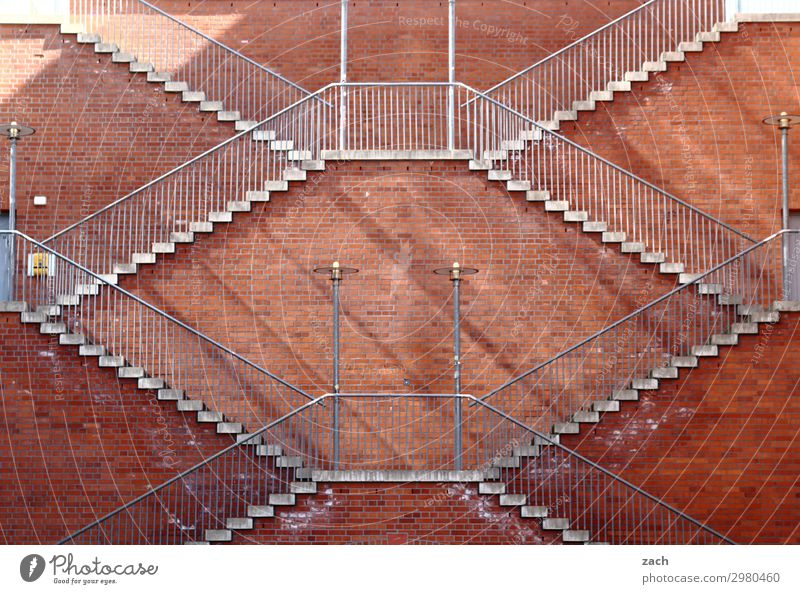 Always on the wall. Ascension. Town Downtown Deserted Wall (barrier) Wall (building) Stairs Facade Brown Red Symmetry Steep Tall Go up Descent Colour photo