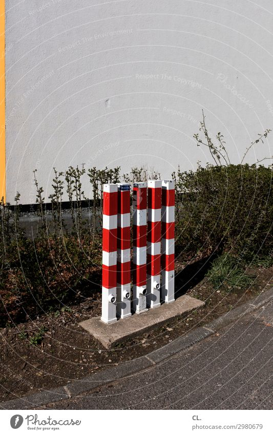 poller red white Plant Hedge Wall (barrier) Wall (building) Transport Traffic infrastructure Lanes & trails Barrier Bollard Gloomy Contentment Equal Protection