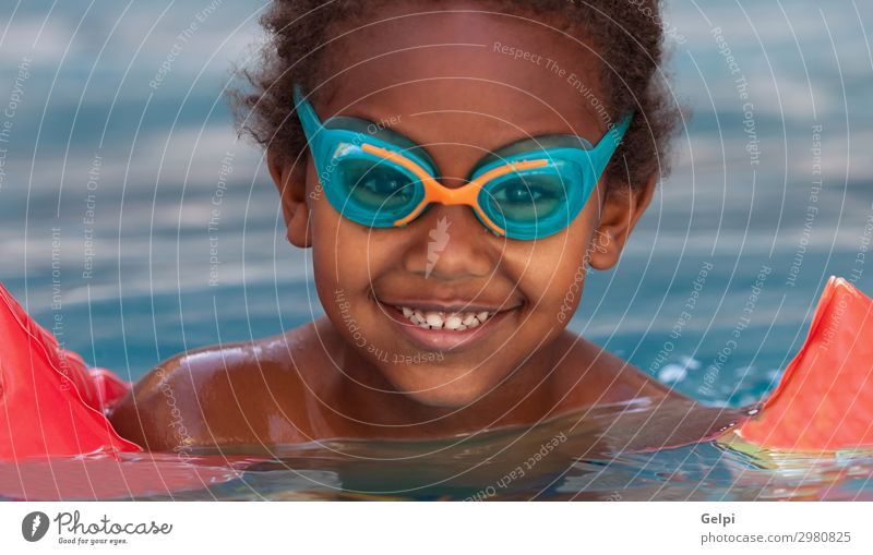 Little african child in the pool Lifestyle Joy Happy Beautiful Relaxation Swimming pool Leisure and hobbies Playing Vacation & Travel Summer Child School