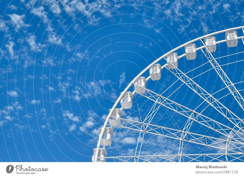 Picture of a Ferris wheel against the blue sky. Joy Leisure and hobbies Summer Entertainment Sky Rotate To enjoy Tall Blue White Joie de vivre (Vitality)