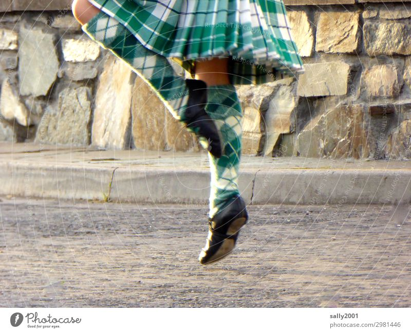 ...off the ground, dancing Scottish... Feminine Girl Legs Feet 1 Human being 8 - 13 years Child Infancy Street Skirt Sock Dance Movement Elegant