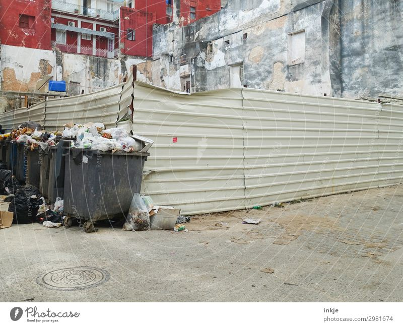 on the corner of Cuba Town Outskirts Deserted Places Building Facade Fence Trash container Waste management Refuse disposal Authentic Crowded Full Dirty Poverty