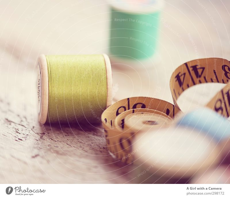 old thread Sewing thread Tape measure Yellow Green Old Old fashioned accessories Craft (trade) Tailoring Rolled Subdued colour Deserted Shallow depth of field