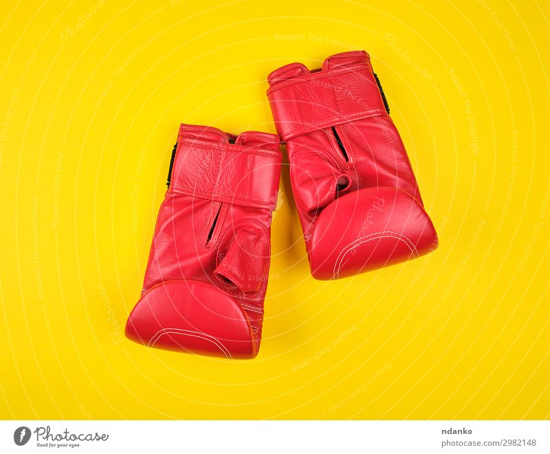 pair of red leather boxing gloves Lifestyle Sports Track and Field Leather Gloves Fitness Yellow Red Protection Competition Power Style Action background boxer