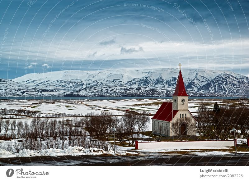On the road to Dalvik, Iceland Vacation & Travel Tourism Trip Ocean Island Winter Snow Mountain Nature Landscape Sky Clouds Bad weather Coast Fjord Church