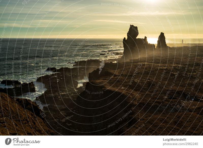 Londrangar in Snaefellsnes peninsula at sunset, Iceland Vacation & Travel Tourism Ocean Mountain Nature Landscape Sky Sunlight Rock Peak Natural Colour