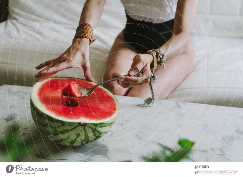 beautiful woman eating watermelon indoor Fruit Nutrition Eating Lunch Spoon Lifestyle Happy Beautiful Summer Human being Feminine Woman Adults Body Hand Legs 1