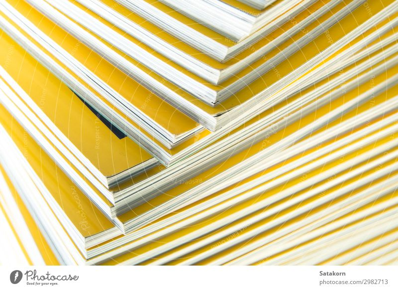 Stack of yellow monthly magazine Reading Book Library Paper Collection Yellow White Colour Accumulation background education Press issue Journalism printing