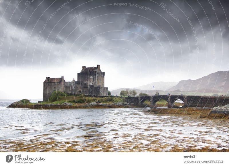 Eilean Donan Castle (Scotland) Landscape Clouds Storm clouds Autumn Bad weather Manmade structures Tourist Attraction Threat Famousness Gray Eilean Donan castle