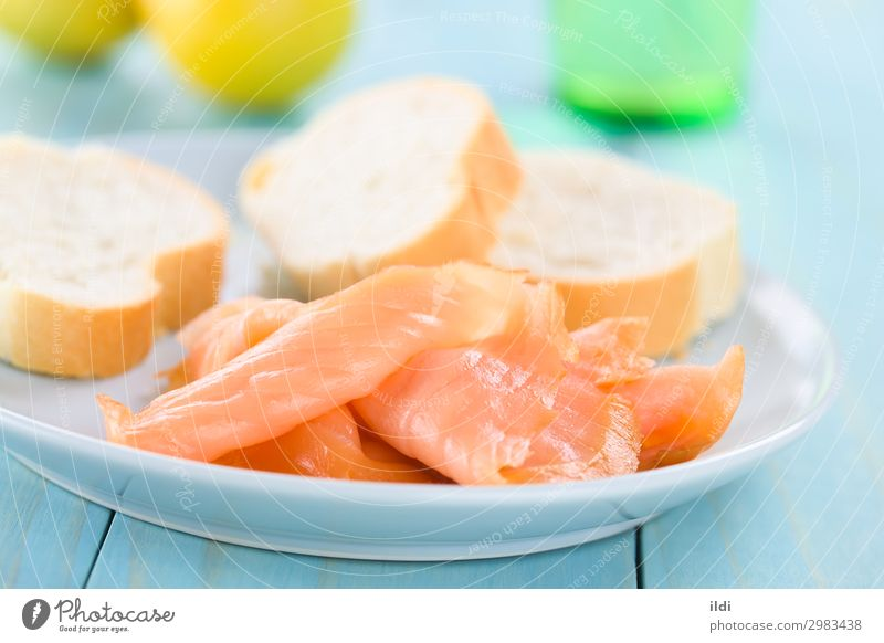 Smoked Salmon Slices Fish Seafood Breakfast Healthy Sliced Gourmet Delicacy Snack Baguette Meal Fat omega 3 filet fillet appetizer cured on blue Horizontal
