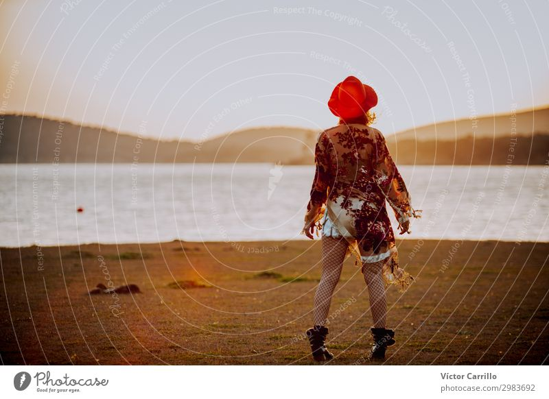 a young woman with red hat in a romantic sunset in a lake Lifestyle Elegant Design Exotic Joy Human being Feminine Young woman Youth (Young adults) Woman Adults