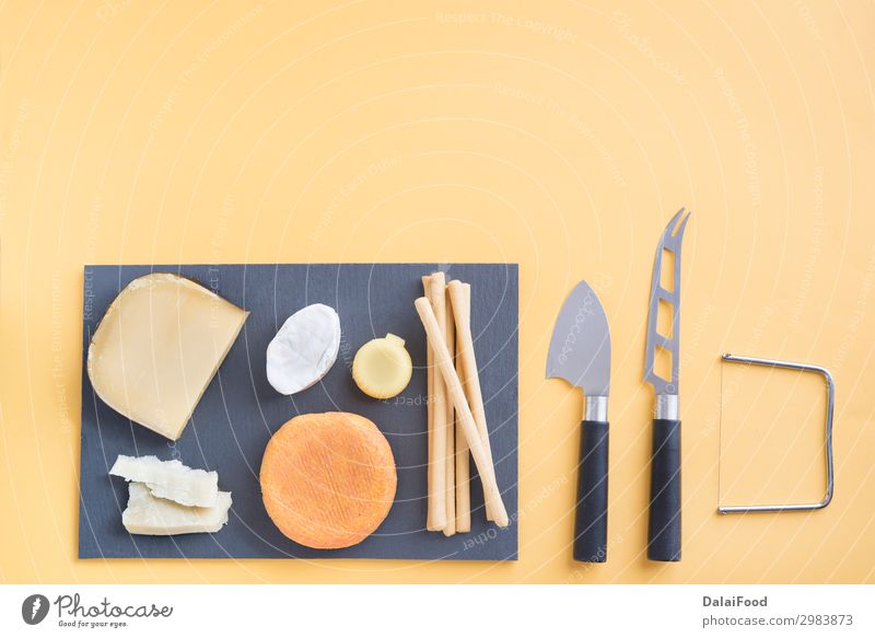Assortment of quality cheese in background Cheese Nutrition Breakfast Table Kitchen Wood Exceptional Fresh Delicious Blue Yellow appetizer assortment board Brie