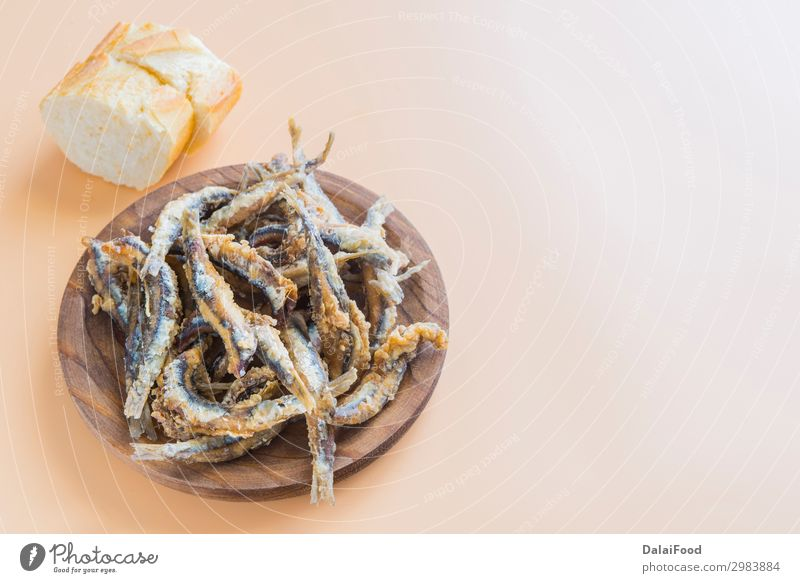 Typical Tapa of Fish in spain (pescaito frito) Seafood Lunch Dinner Diet Plate Ocean Restaurant Fresh Delicious Green anchovies anchovy appetizer background