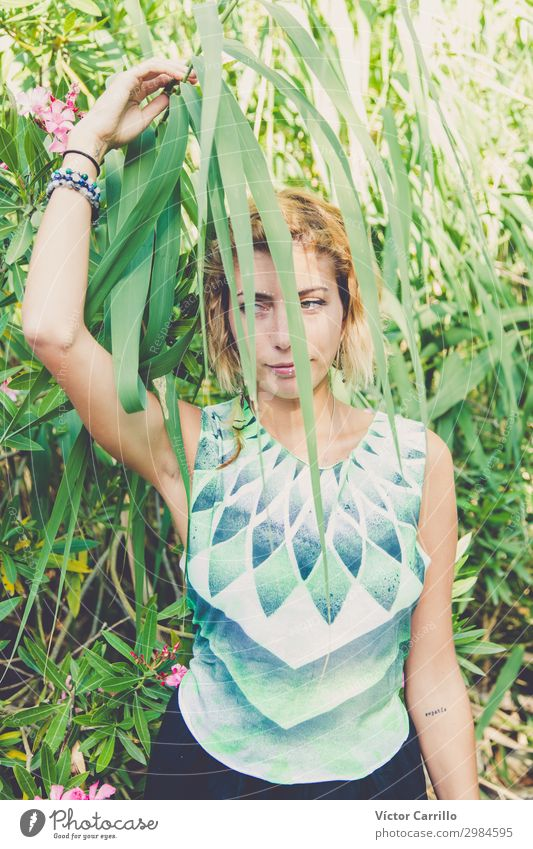 A Blonde pretty young boho style woman in a river in summer Woman Human being Nature Youth (Young adults) Young woman Plant Beautiful Green Eroticism