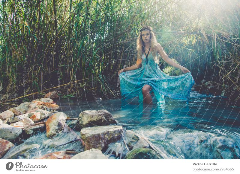 A Blonde pretty young boho style woman in a river in summer Lifestyle Elegant Style Design Exotic Feminine Young woman Youth (Young adults) Woman Adults 1