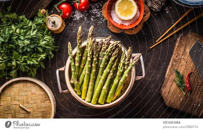 Cooking green asparagus Food Vegetable Nutrition Organic produce Vegetarian diet Diet Crockery Pot Style Healthy Eating Living or residing Restaurant Design