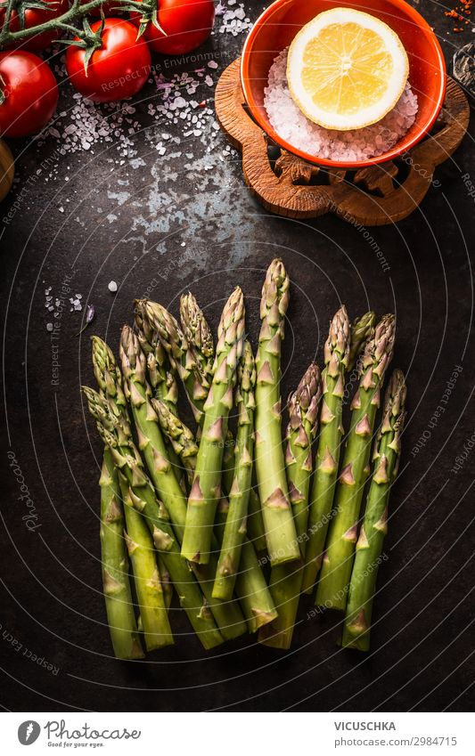 Green asparagus on a dark rustic kitchen table Food Vegetable Nutrition Organic produce Vegetarian diet Diet Design Healthy Eating Asparagus cooking preparation