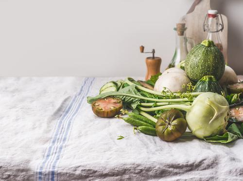 Various green organic vegetables on the kitchen table Food Vegetable Nutrition Organic produce Vegetarian diet Diet Crockery Style Healthy Eating Table Kitchen