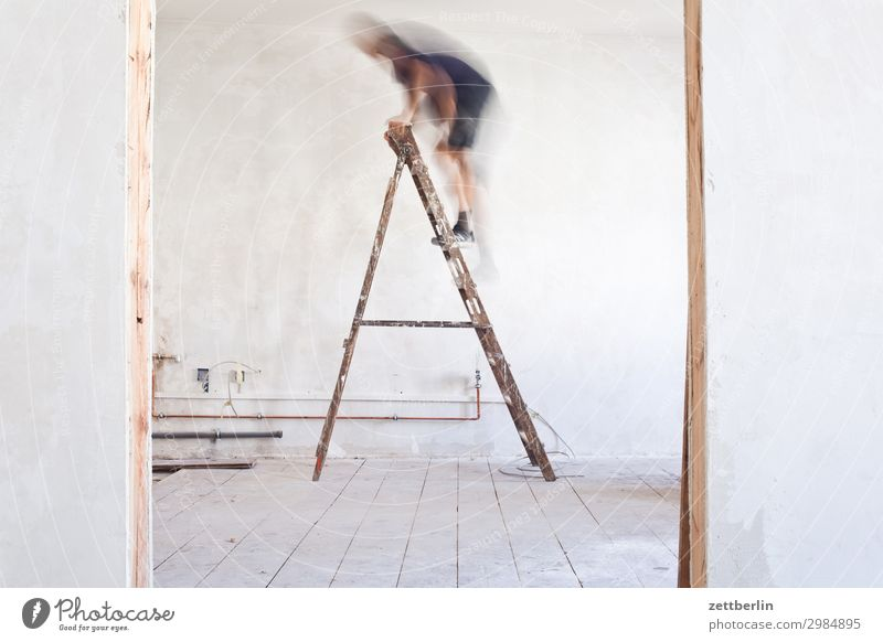 Human being Man Interior design Wall (building) Copy Space Wall (barrier) Living or residing Flat (apartment) Room Door Construction site Climbing Career Ladder