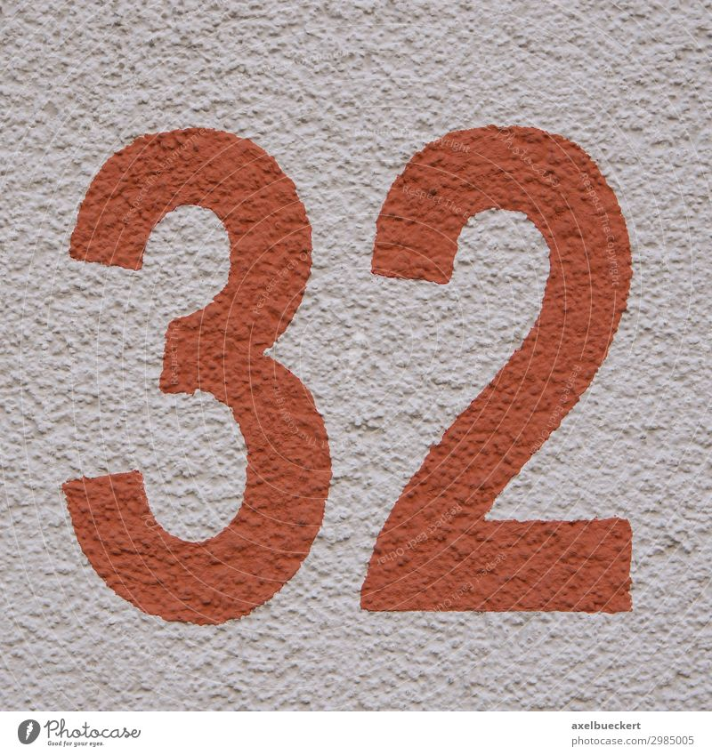 red number 32 - house number thirty-two Design Wall (barrier) Wall (building) Facade Red Symbols and metaphors Square Digits and numbers House number