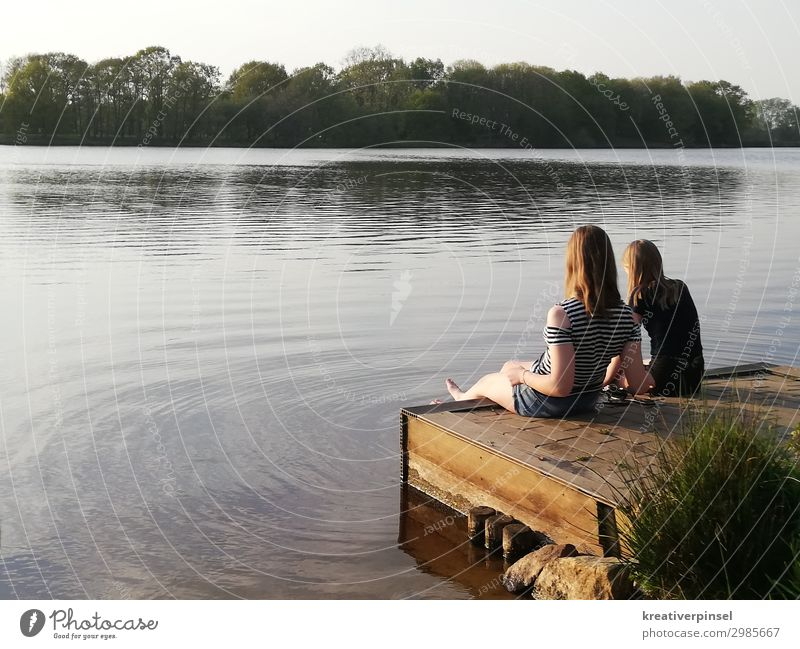 At the lake by the lake Lake Lake Water Surface of water dangle one's feet Feet washing Foot in water Relaxation Summer's day holidays Nature Love of nature