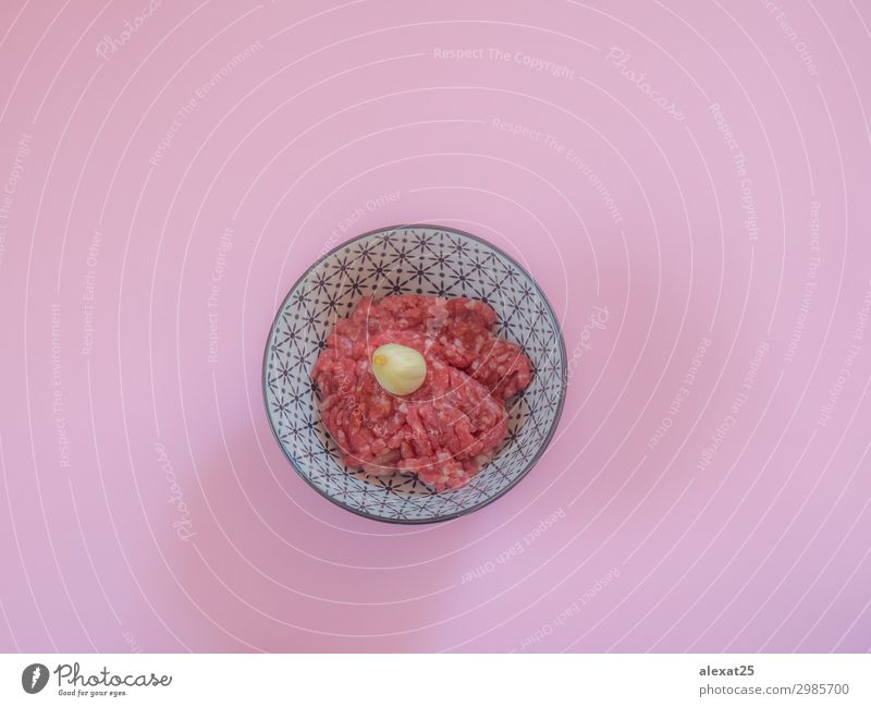 Minced beef meat in a bowl on pink background Meat Nutrition Fresh Pink Red Beef burger butcher Cooking fat flat lay food Ground Hamburger healthy Heap