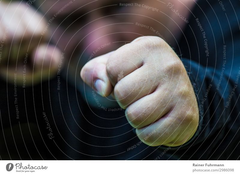"""an aggressive man clenching his fists Human being Masculine Man Adults 1 Fight Argument Aggression Emotions Bravery Animosity Frustration Revenge Force """"Racket"""