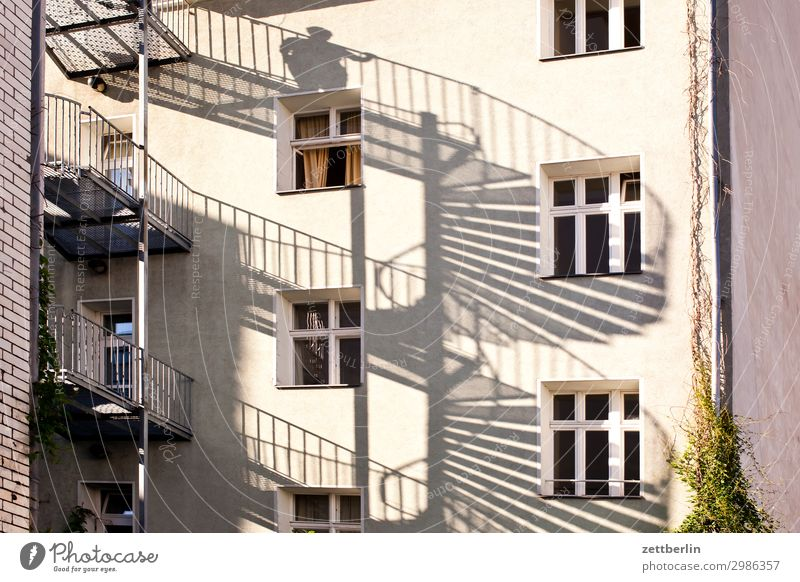 Man on the spiral staircase House (Residential Structure) Apartment Building Tower block Apartment house Living or residing Residential area Town Berlin