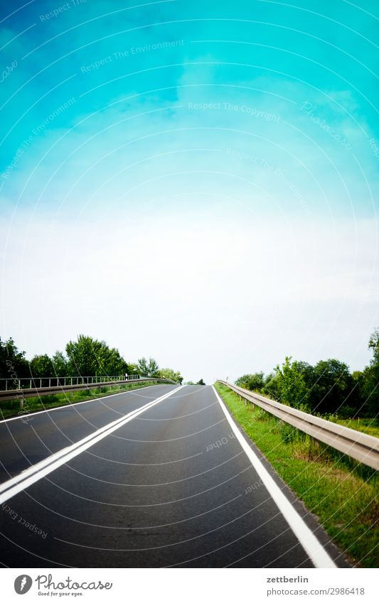 target Street Country road Tracks Overtake Crash barrier Right ahead Center line Signs and labeling Traffic lane Lane markings Sky Heaven Landscape