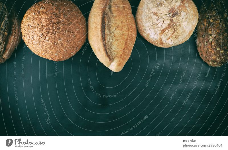 baked various loaves of bread Bread Nutrition Eating Breakfast Diet Table Wood Dark Fresh Delicious Natural Above Brown Black White Tradition Baking Bakery