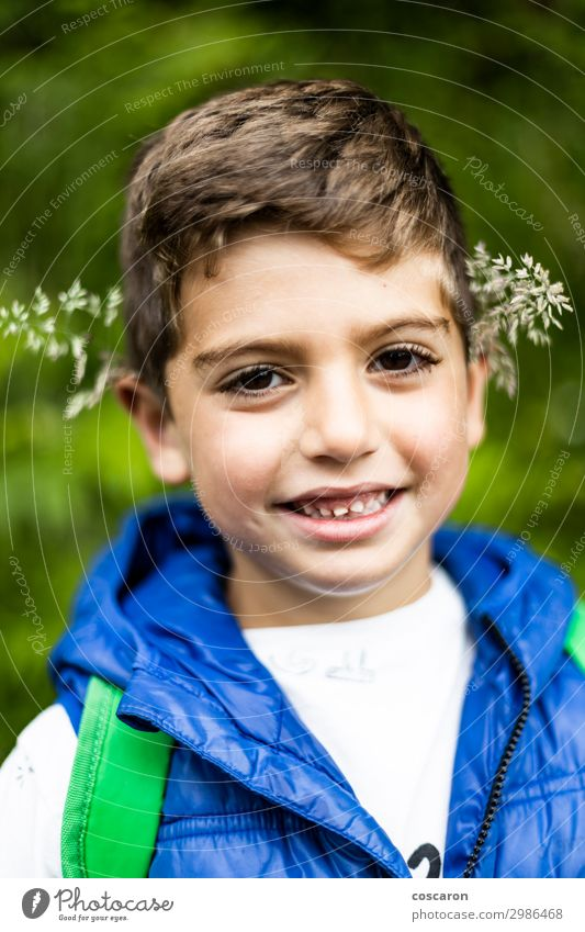 Beautiful boy with flowers in his ears Child Human being Vacation & Travel Nature Summer Plant Blue Colour Green White Landscape Flower Joy Forest Mountain