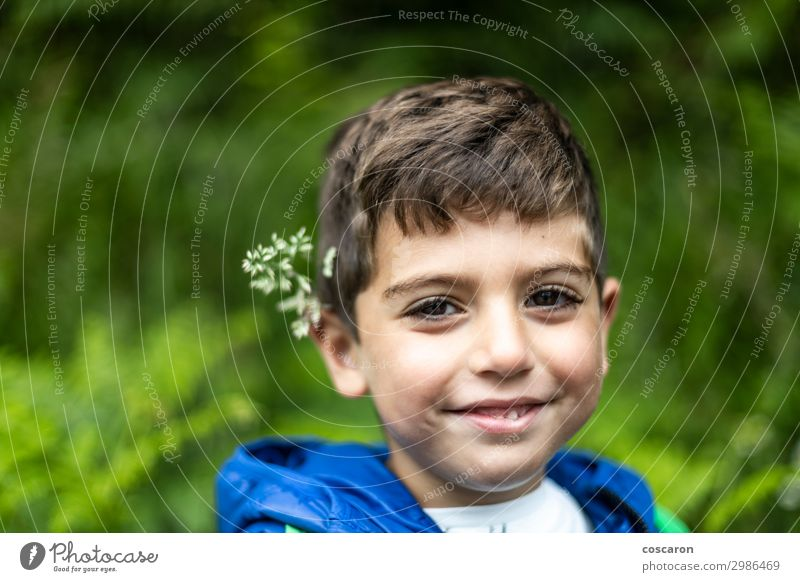 Beautiful boy with flowers in his ears Lifestyle Joy Happy Harmonious Vacation & Travel Tourism Trip Summer Hiking Child School Human being Toddler Boy (child)