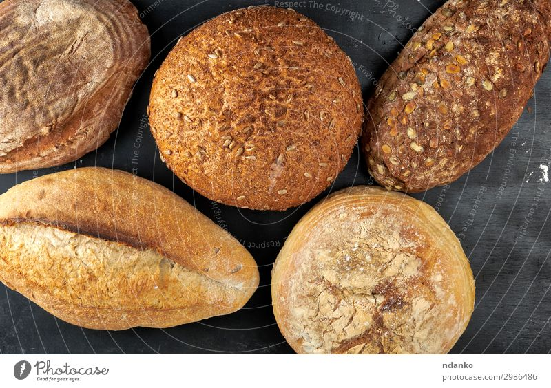 baked various loaves of bread Bread Nutrition Eating Breakfast Diet Table Wood Dark Fresh Delicious Natural Above Brown Black Tradition Baking Bakery board