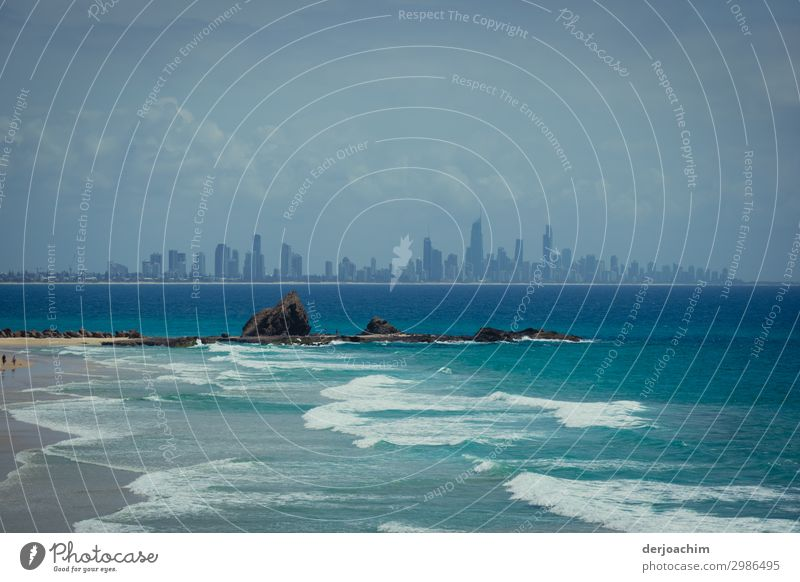 Isolation / rocks in the water and in the background the city with the contours of the high-rise buildings of Surfers Paradise Joy Harmonious Well-being Trip