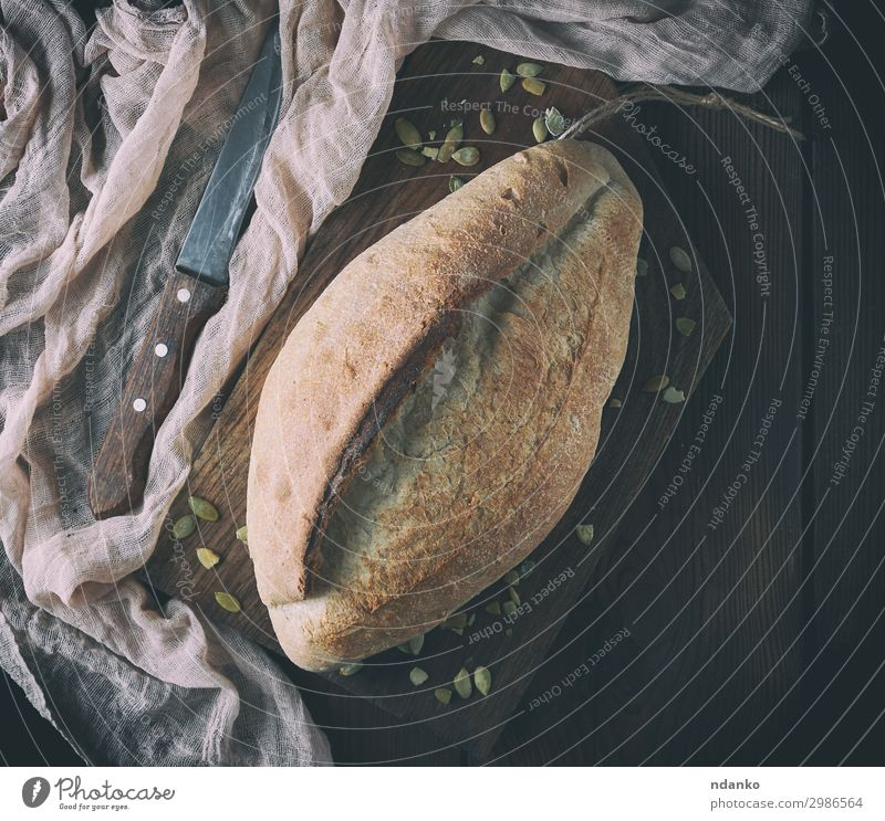 baked crisp oval bread and vintage knife Bread Nutrition Eating Table Kitchen Wood Fresh Natural Above Brown Tradition Baking Bakery board Crust Flour food