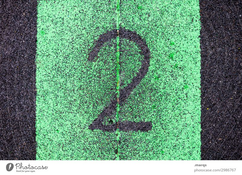 2 Success Sporting Complex Sporting event Plastic Digits and numbers Authentic Green Black Numbers Colour photo Exterior shot Close-up Structures and shapes