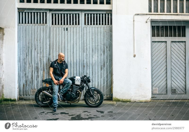 Biker posing with a motorcycle Lifestyle Style Trip Engines Human being Man Adults Street Vehicle Motorcycle Bald or shaved head Smiling Sit Authentic Retro