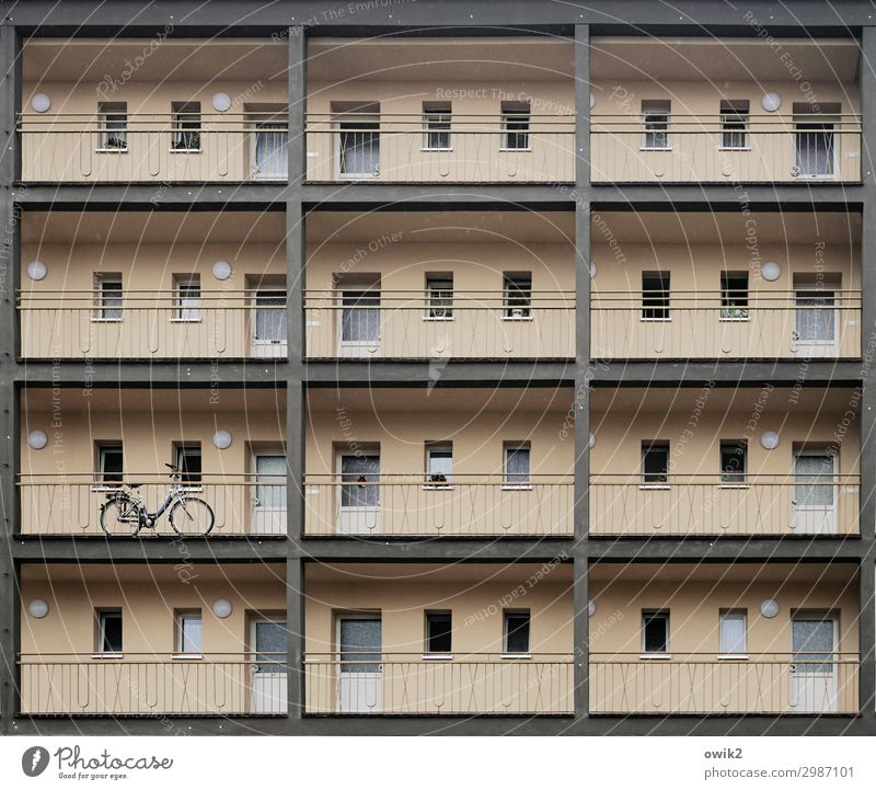safe-deposit boxes Town Populated House (Residential Structure) High-rise Wall (barrier) Wall (building) Facade Window Door Bicycle Sharp-edged Simple Above