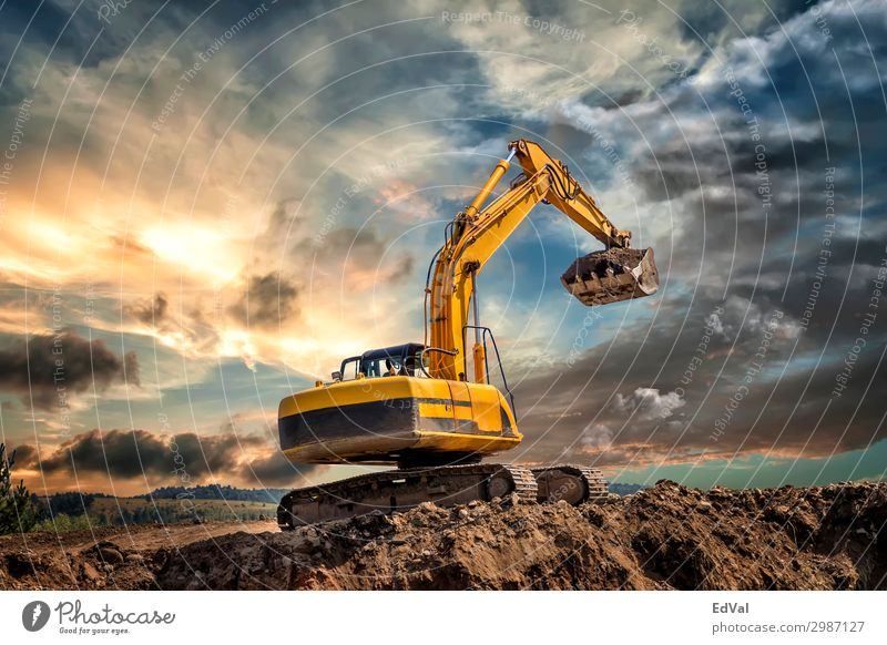 Crawler excavator during earthmoving works on construction site at sunset colorful impressive loader hydraulic scenic amazing tractor industrial industry