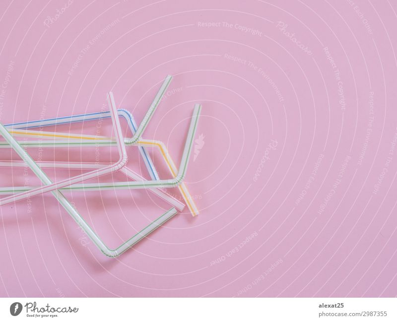 Plastic straws on pink background with copy space Colour Red Joy Environment Feasts & Celebrations Copy Space Pink Design Fresh Photography Beverage Drinking