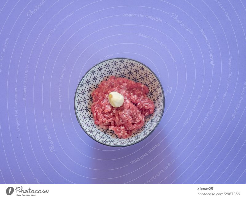 Minced beef meat in a bowl on purple background Meat Nutrition Fresh Red Beef burger butcher Cooking fat flat lay food Ground Hamburger healthy Heap Ingredients