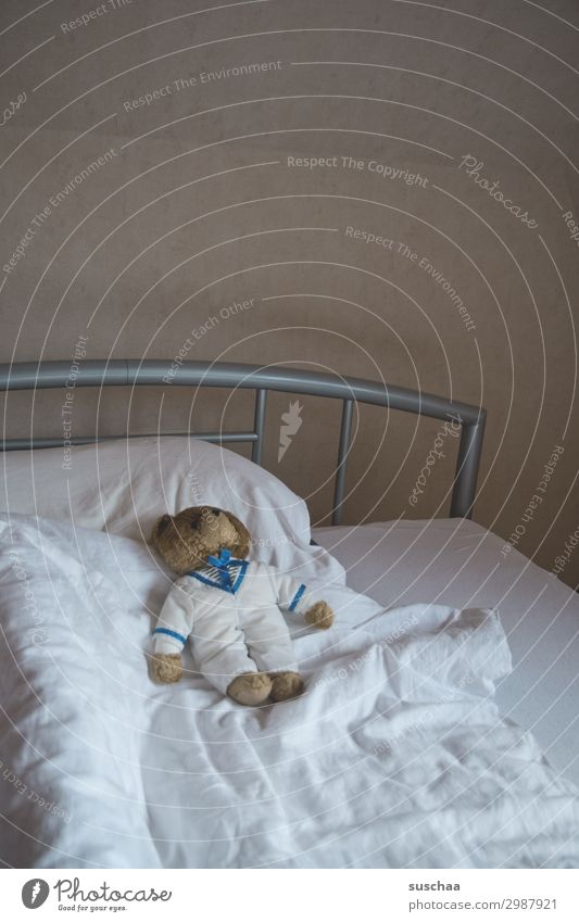 empty bed with an old teddy bear Bed Duvet Pillow Teddy bear Retro iron rod Bedstead Wall (building) Mattress Sheet White minimal Sleep go to bed Dream Cuddling