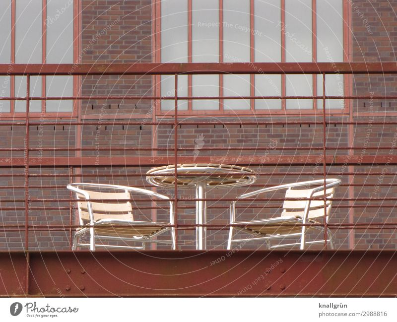 Cosy spot Industrial plant Wall (barrier) Wall (building) Facade Terrace Garden table Garden chair Steel carrier Communicate Sharp-edged Historic Town Brown
