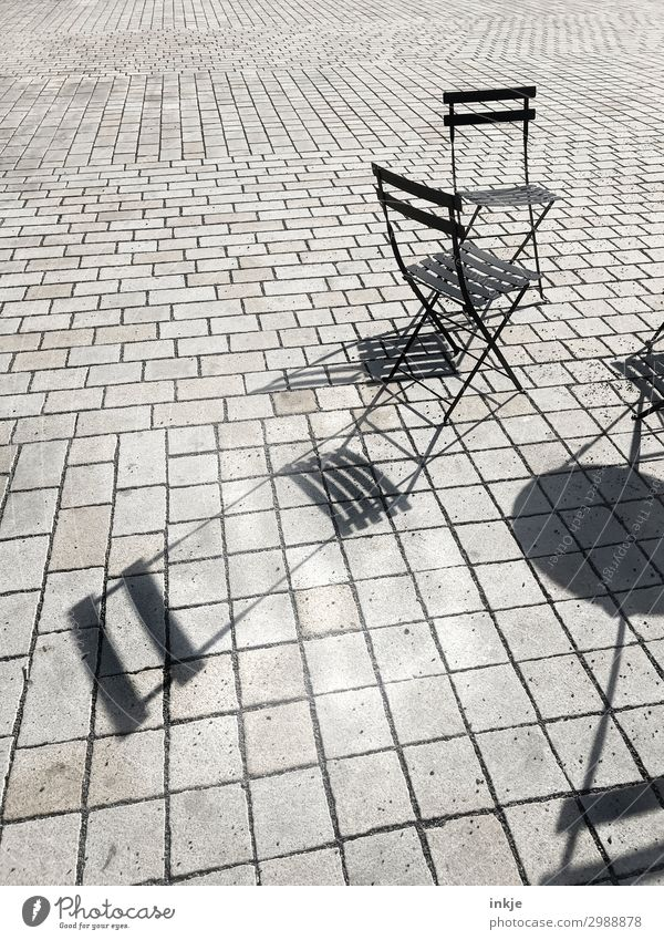 Prague street café Deserted Places Marketplace Folding chair Chair Line Gray Black Shadow Sidewalk café Paving stone Pave Colour photo Black & white photo
