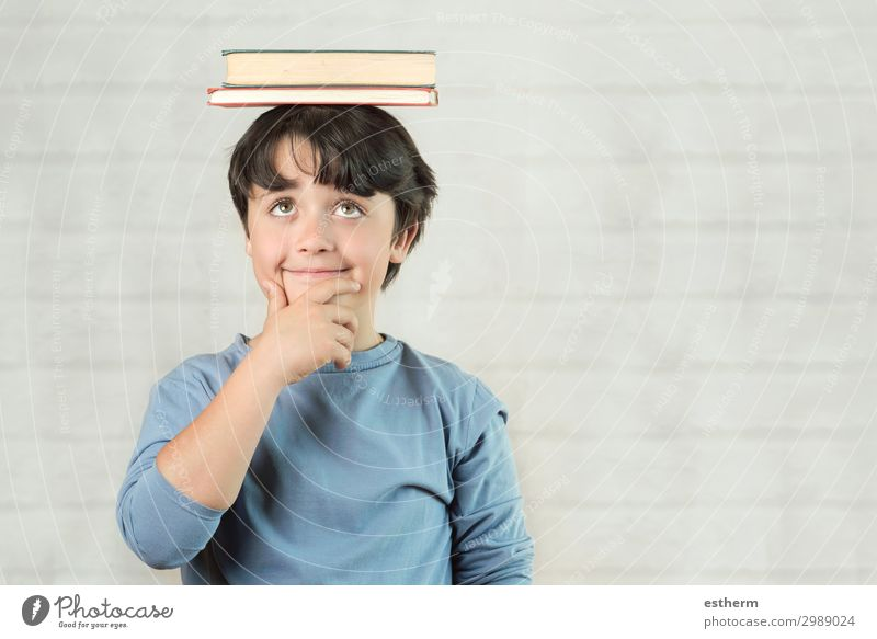 happy and smiling child with books on head Child Human being Joy Lifestyle Emotions Playing School Think Masculine Smiling Infancy Happiness Book Idea Observe