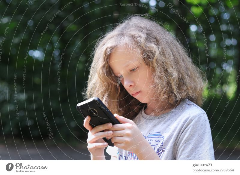 In another world Boy's digging into his cell phone... Boy (child) Infancy Life 1 Human being 8 - 13 years Child Summer Park Blonde Long-haired Curl Communicate